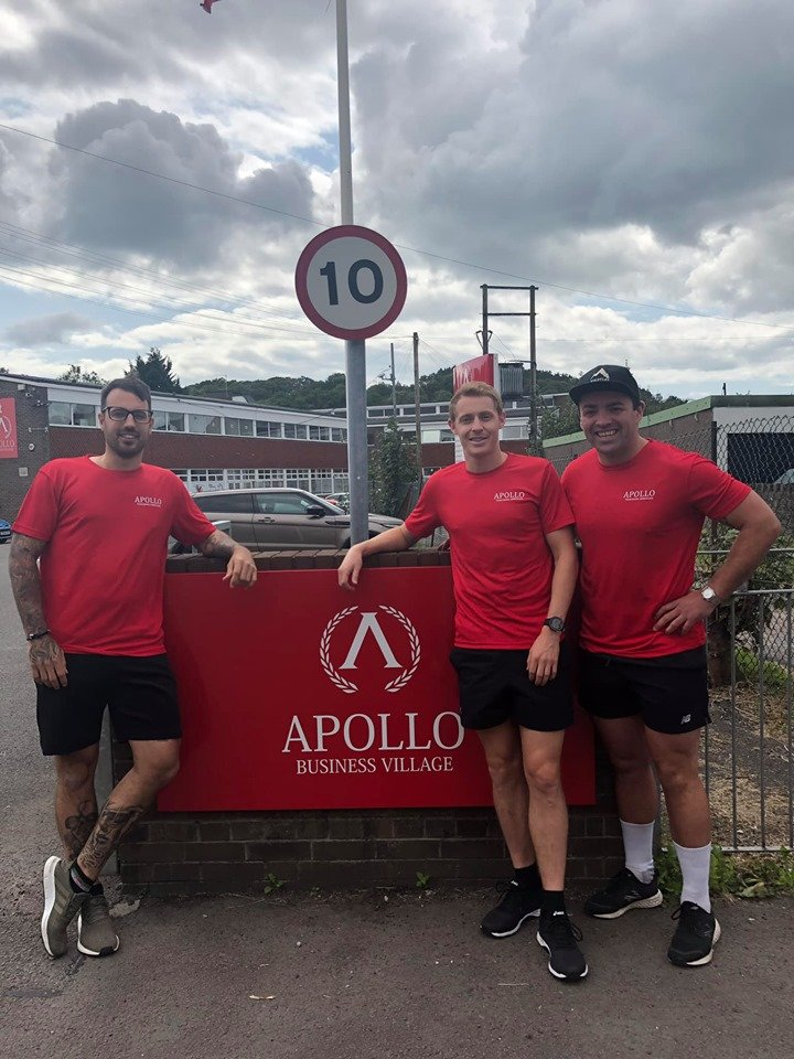 Paul, Jon and Will stand outside the Apollo Business Village office in their red Apollo t-shirts.