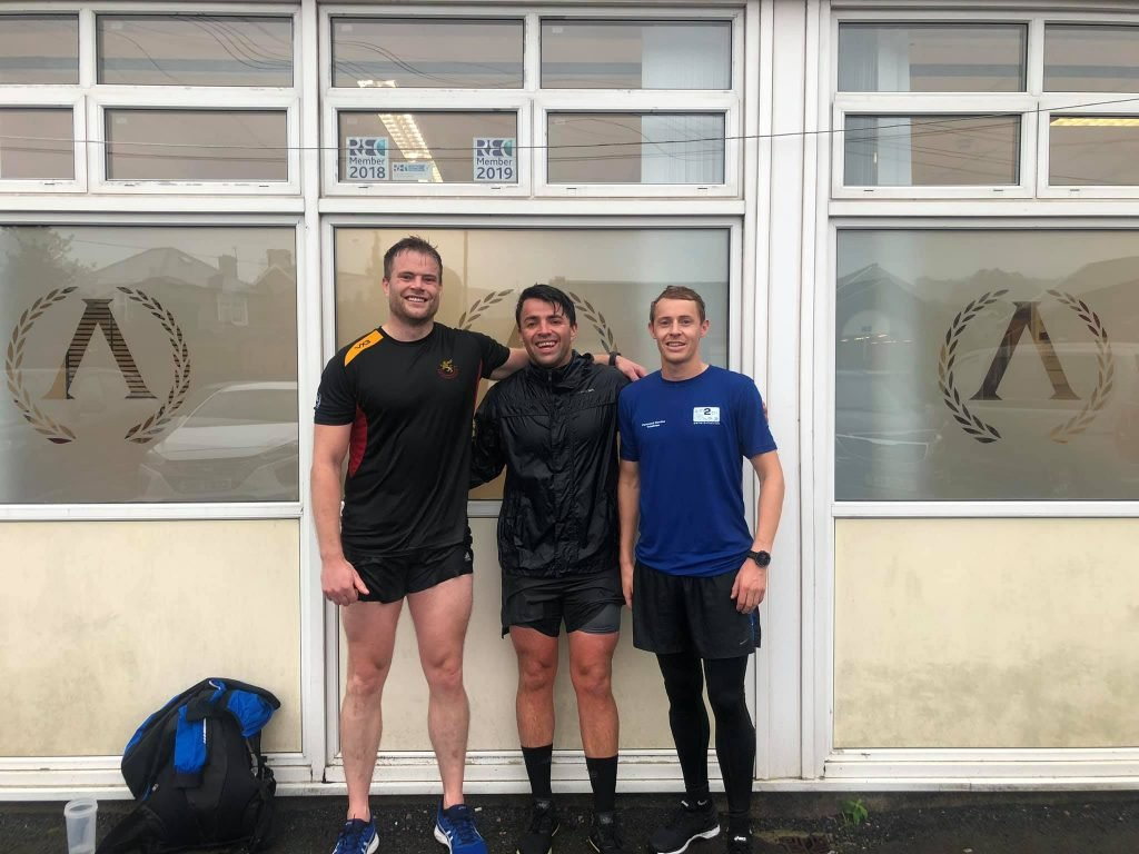 Marc, Will and Jon are standing outside the Apollo offices looking very wet after getting caught in the rain